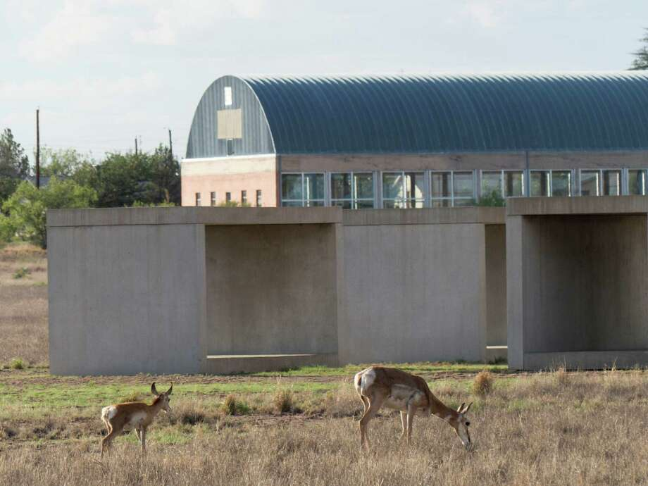 Pronghorns graze by Donald Judd's sculptures in Marfa, the West Texas town that's attracting the affluent, who are driving home prices and property taxes out of reach for many. Photo: Billy Calzada, Staff / San Antonio Express-News