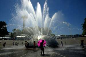 Take on the Seattle Center International Fountain on a hot summer day.