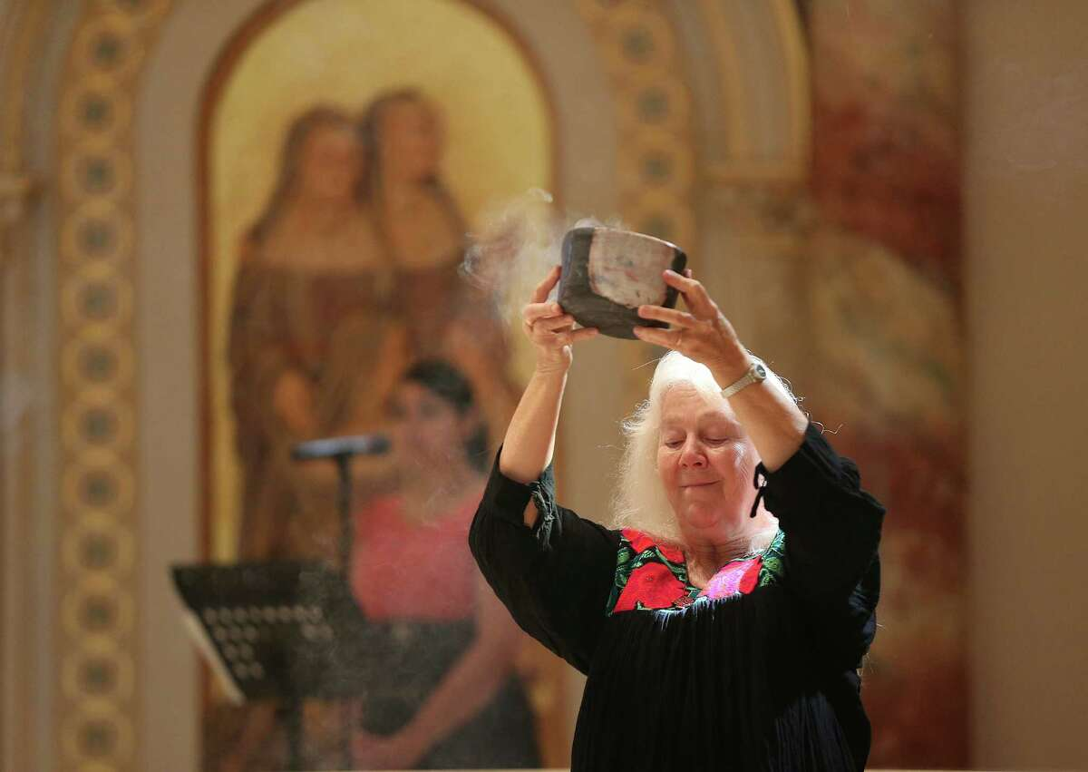 Sister Martha Ann Kirk carries a censer at the start of a Eucharistic Celebration for Sister of Charity of the Incarnate Word installation of the 18th General Leadership Team at the Chapel of the Incarnate Word, Sunday, July 13, 2014. A team of five nuns was installed with Sister Teresa Maya, CCVI as their Congregational Leader. The leadership change happens every four years.
