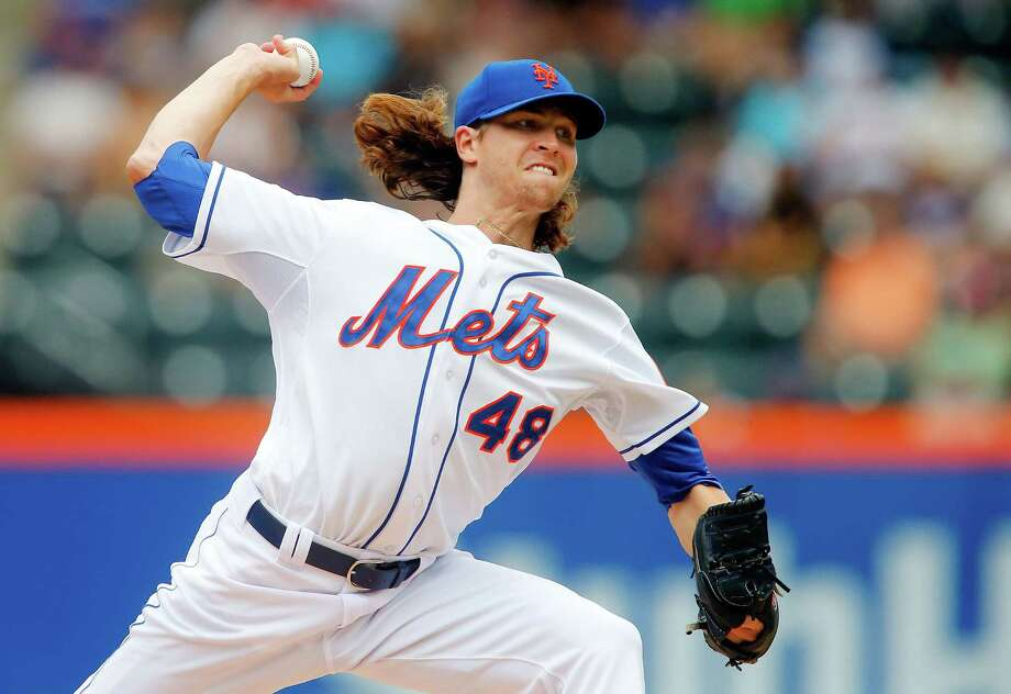 NEW YORK, NY - JULY 13:  Jacob deGrom #48 of the New York Mets pitches in the first inning against the Miami Marlins at Citi Field on July 13, 2014 in the Flushing neighborhood of the Queens borough of New York City.  (Photo by Jim McIsaac/Getty Images) ORG XMIT: 477586375 Photo: Jim McIsaac / 2014 Getty Images
