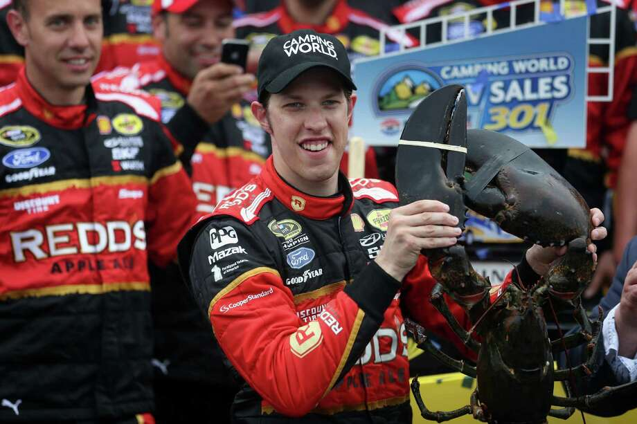 LOUDON, NH - JULY 13:  Brad Keselowski, driver of the #2 Redds Ford, celebrates in victory lane with a lobster after winning the NASCAR Sprint Cup Series Camping World RV Sales 301 at New Hampshire Motor Speedway on July 13, 2014 in Loudon, New Hampshire.  (Photo by Nick Laham/Getty Images) ORG XMIT: 464037089 Photo: Nick Laham / 2014 Getty Images