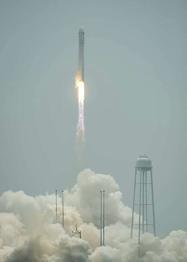 The Orbital Sciences Corporation Antares rocket launches with the Cygnus spacecraft onboard, Sunday, July 13, 2014, at NASA's Wallops Flight Facility in Virginia.  The rocket will carry the Cygnus spacecraft filled with over 3,000 pounds of supplies to the International Space Station in the company's second contracted cargo delivery flight to the space station for NASA. Photo: Bill Ingalls, AP / (NASA/Bill Ingalls)2014