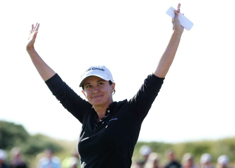 Mo Martin of the U.S celebrates after winning the Women's British Open golf championship at the Royal Birkdale Golf Club, in Southport, England, Sunday, July 13, 2014. (AP Photo/Scott Heppell) ORG XMIT: NSH142 Photo: Scott Heppell / AP