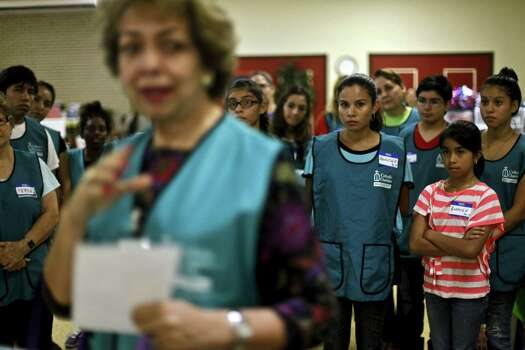 New volunteers receive an orientation at the Sacred Heart Catholic Church in McAllen, Texas, where many of the groups have converged to help undocumented women and children who have recently crossed into south Texas. Volunteers and charity groups have come to the aid of undocumented migrants crossing the border. Photo: Michael Robinson Chavez, MBR / Los Angeles Times