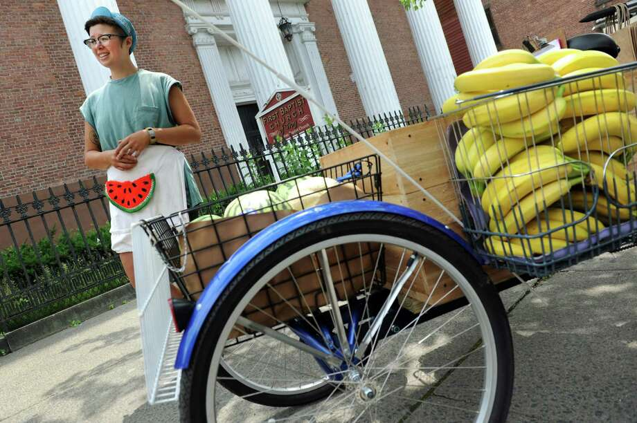 Employee Mae Yau sells fruits and vegetables for Three Wheel Produce on Tuesday, July 8, 2014, at Barker Park in Troy, N.Y. (Cindy Schultz / Times Union) Photo: Cindy Schultz / 00027666A