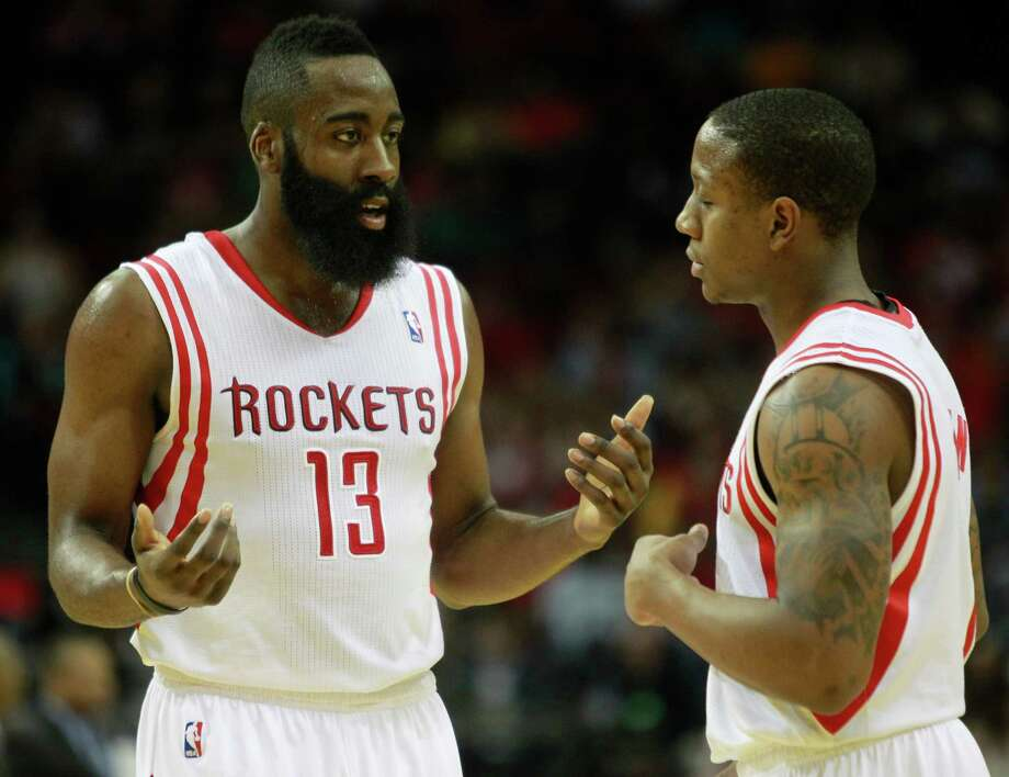 Isaiah Canaan, right, would like nothing better than to fill the void left by the trade of Jeremy Lin and provide James Harden and the Rockets with some valuable support off the bench. Photo: Melissa Phillip, Staff / © 2014  Houston Chronicle