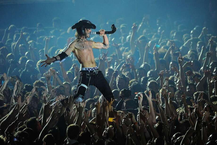 French Frah:Shaka Ponk singer Frah (Francois Charon) whips fans into a frenzy while crowd-surfing on his knees at the   Francofolies festival in La Rochelle, France. Photo: Xavier Leoty, AFP/Getty Images