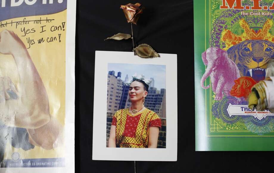 A photograph of Frida Kahlo hangs on Jean Franco Pilas' wall in his San Francisco home. Photo: Mike Kepka, The Chronicle