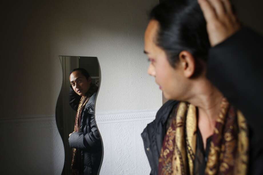 Jean Franco Pilas heads to work at the Stable Cafe in San Francisco. Over the years he has had many people tell him how much he resembles famed artist Frida Kahlo. An artist himself he considers this to be a great gift. Photo: Mike Kepka, The Chronicle