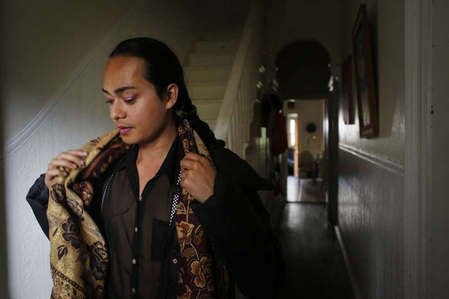 Jean Franco Pilas heads to work at the Stable Cafe in San Francisco. Over the years he has had many people tell him how much he resembles famed artist Frida Kahlo. He considers the similarities to be a great gift. Photo: Mike Kepka, The Chronicle