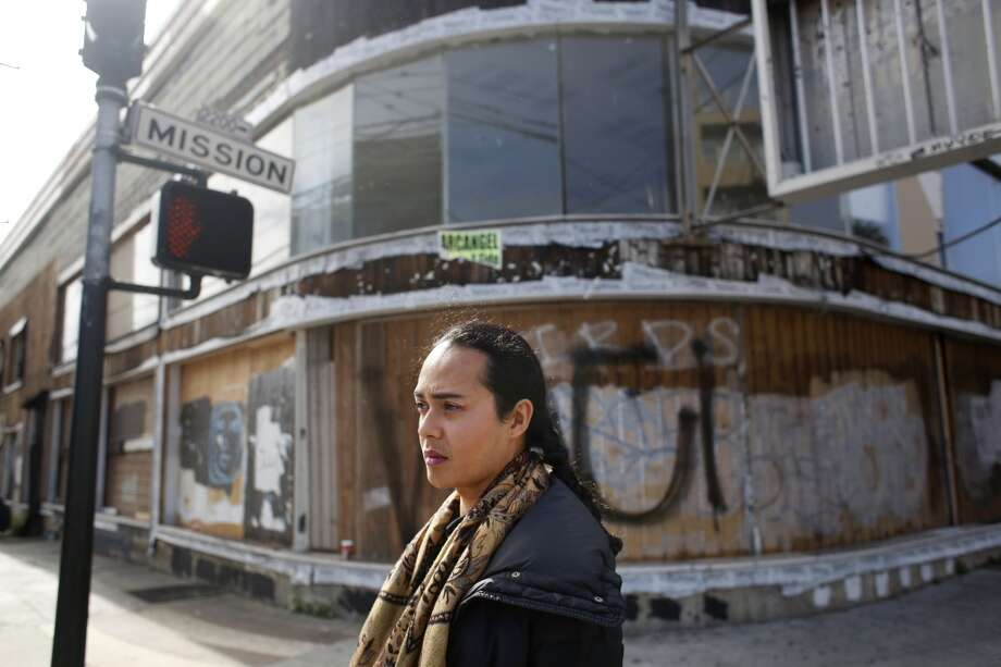 San Francisco artist Jean Franco Pilas walks to work in the Mission. Photo: Mike Kepka, The Chronicle