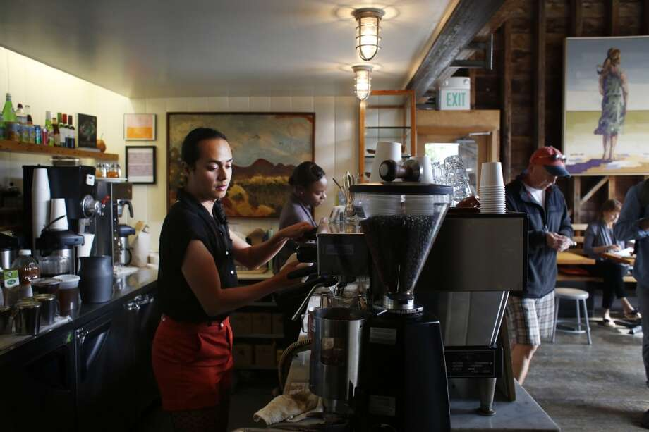 Jean Franco Pilas make a coffee drink at the Stable Cafe in San Francisco. Often people people come in and remark on his resemblance to Frida Kahlo and on special occasions has been encouraged to come to work dressed as the artist. Photo: Mike Kepka, The Chronicle