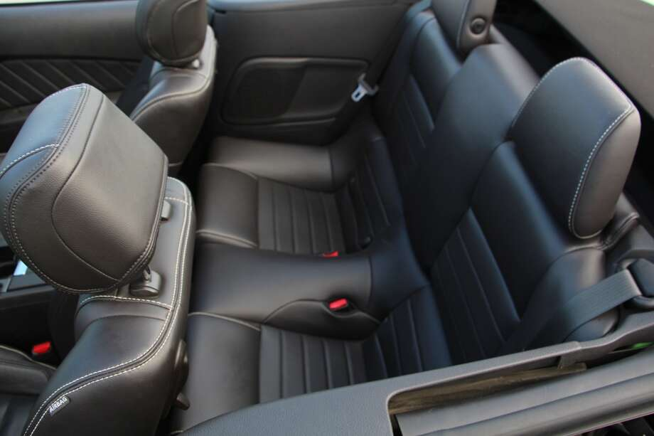 The rear seats, like those of most four-seat convertibles, are adequate, but only for a short trip across town.