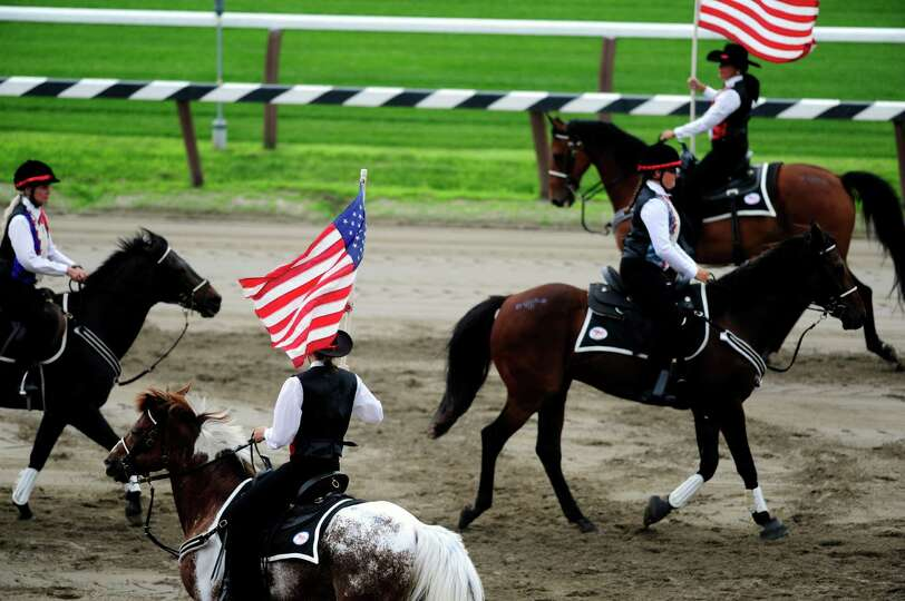 Members of the Spirit of Long Island Mounted Drill Team perform at the Open House for the Saratoga R