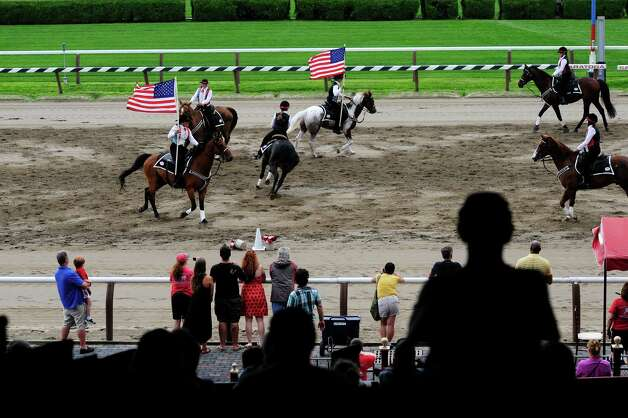 Members of the Spirit of Long Island Mounted Drill Team perform at the Open House for the Saratoga Race Course on Sunday, July 13, 2014, in Saratoga Springs, N.Y.  (Paul Buckowski / Times Union) Photo: Paul Buckowski / 00027731A
