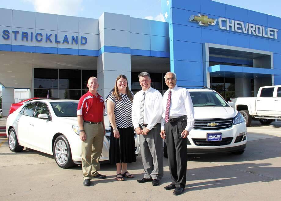 Strickland Chevrolet recently lent two program vehicles for one month to Pearland ISD Teachers of the Year Taresa Jacobsen and Mark Lesmeister. From left are: Lesmeister, Jacobsen, general sales manager Todd Harvey and general manager Lee Mehta. Photo: Courtesy Pearland ISD
