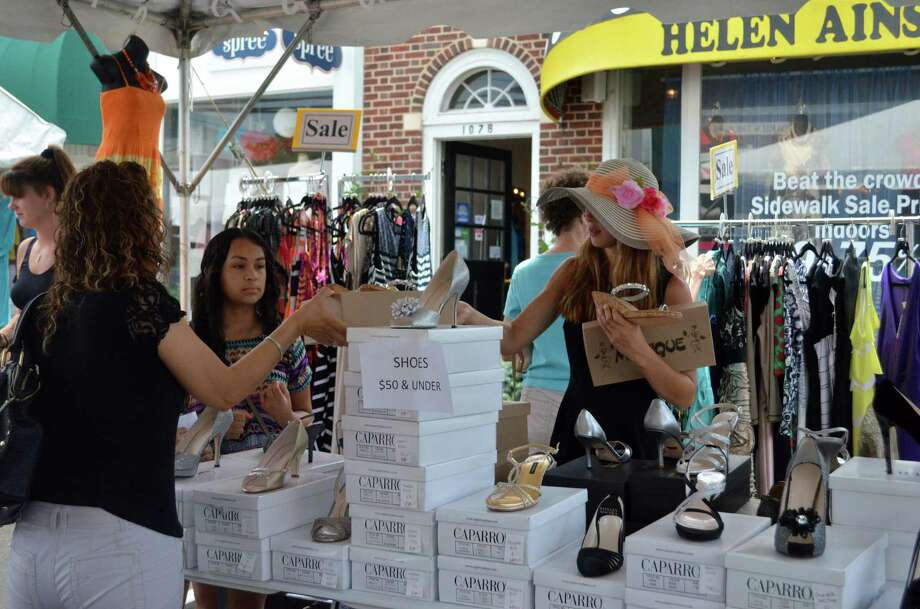 Employees from local stores, like Helen Ainson, assisted shoppers at the Darien Sidewalk Sales and Family Fun Days, which ran from July 10 to July 12. Photo: Megan Spicer / Darien News