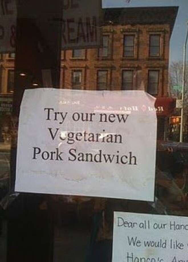 From the looks of things, pork is facing an identity crisis at this dining establishment. Brooklyn, New York.  Photo: Stav Birnbaum, Signspotting.com