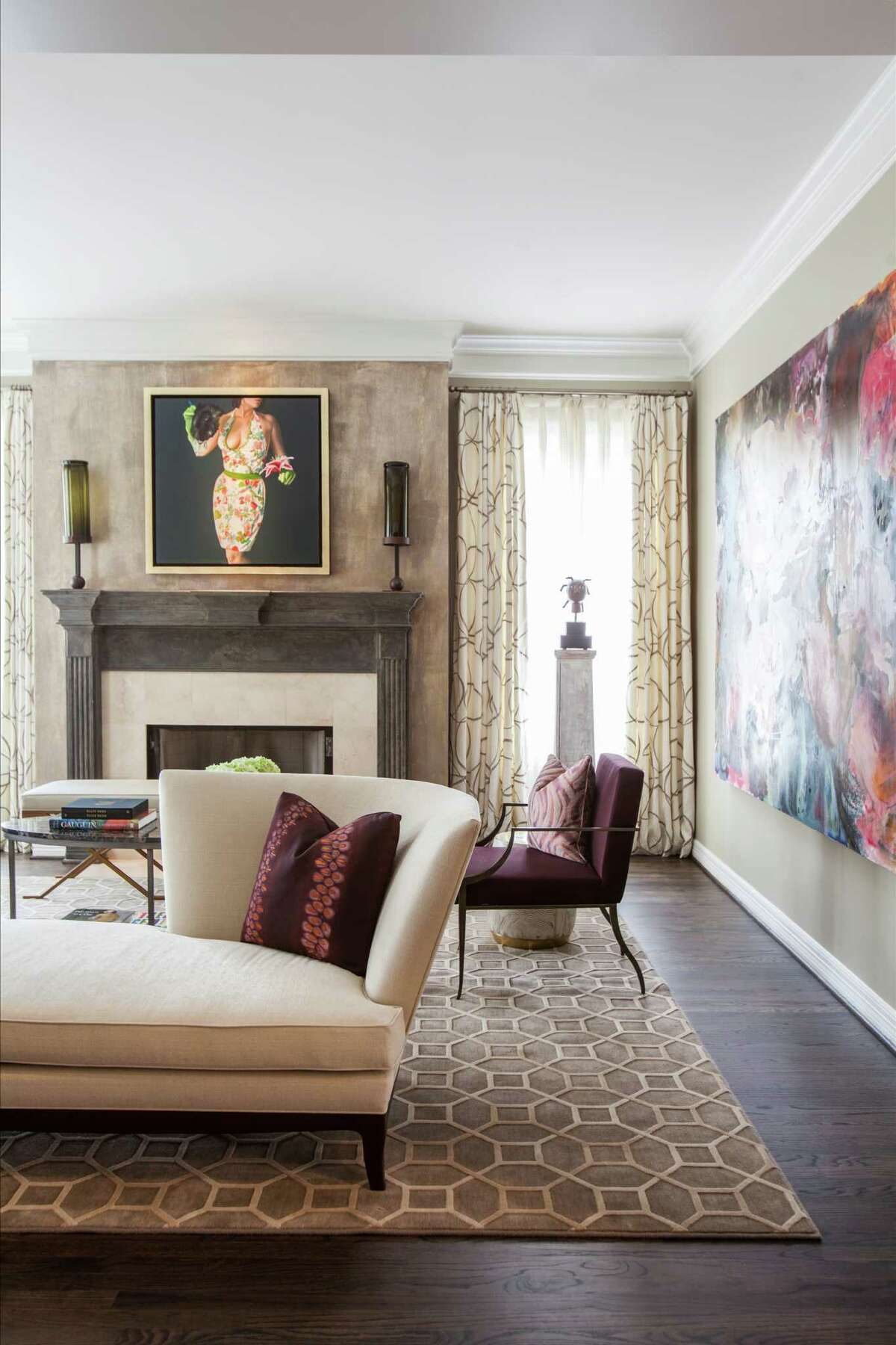 Neutral colors, including a Kravet rug and a tête-à-tête sofa by Donghia, are set against the newly espresso-stained hardwood floors in the formal living room of this Tanglewood home.