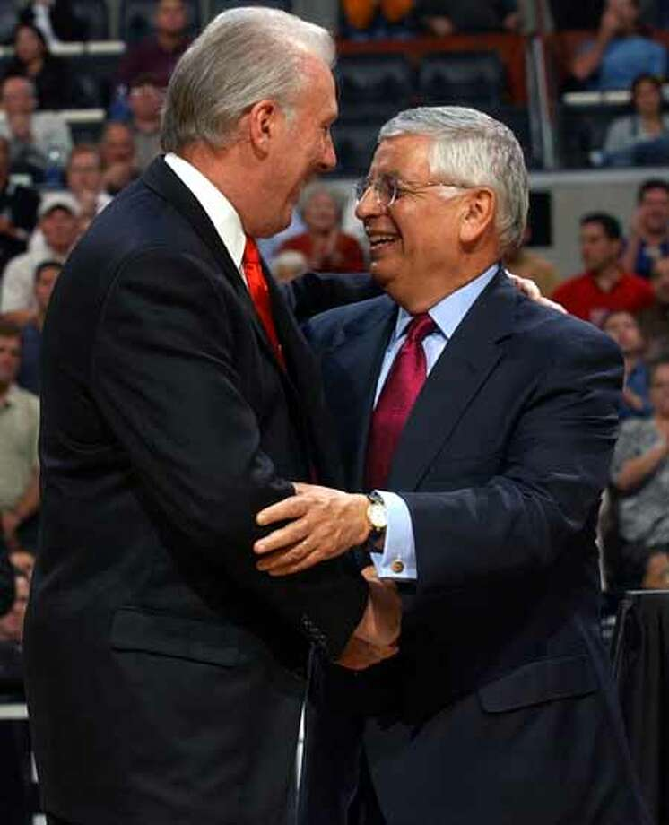 SPORTS   ---   NBA Commissioner David Stern, right, greets Spurs coach Gregg Popovich during the Spurs' championship ring ceremony Tuesday Night Oct. 28, 2003 at the SBC Center before the start of their game against the Phoenix Suns.        (WILLIAM LUTHER/STAFF) Photo: WILLIAM LUTHER, SAN ANTONIO EXPRESS-NEWS / SAN ANTONIO EXPRESS-NEWS