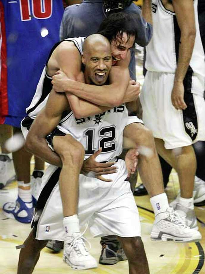 San Antonio Spurs' Manu Ginobili jumps on the back of teammate Bruce Bowen after they defeated the Detroit Pistons, 81-74, to win the NBA Championship in game seven of the NBA finals in San Antonio, Thursday, June 23, 2005. (AP Photo/M. Spencer Green) Photo: M. SPENCER GREEN, AP / AP