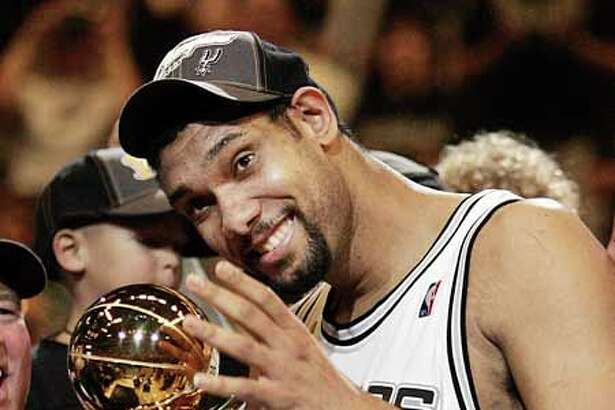 San Antonio Spurs' Tim Duncan celebrates as he was named the MVP of the NBA Finals. San Antonio won, 81-74, to win the championship.in game seven of the NBA finals in San Antonio, Thursday, June 23, 2005. (AP Photo/Eric Gay