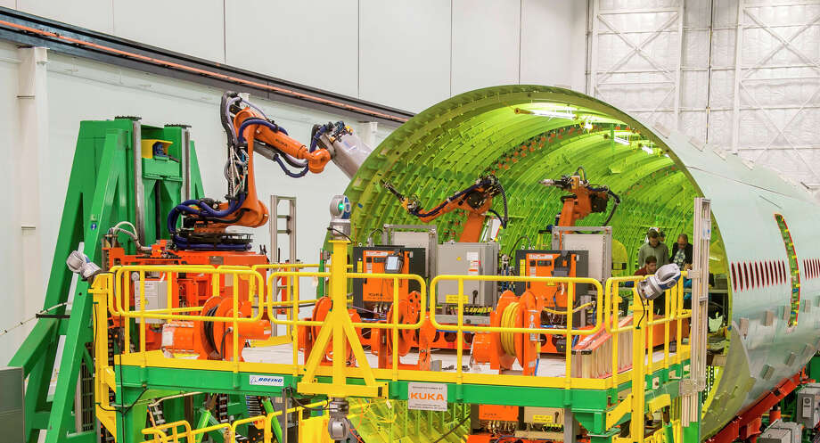 Boeing tests Fuselage Automated Upright Build, which uses automated, guided robots to fasten together 777 fuselage panels, in its Anacortes, Wash., facility. Photo: Gail Hanusa, The Boeing Co. / Copyright © 2014  Boeing. All Rights Reserved.