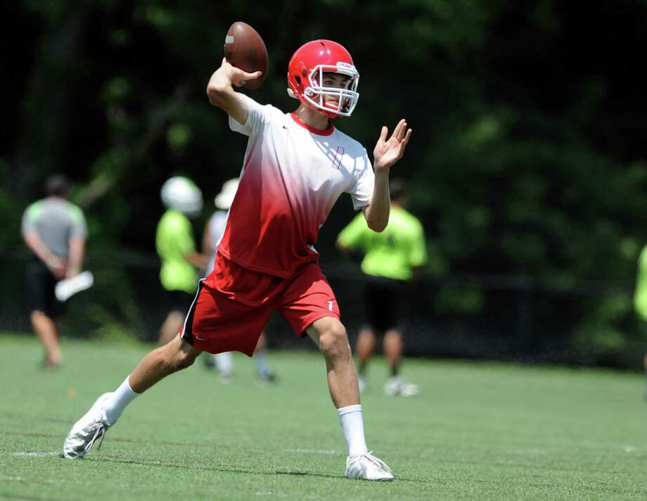New Canaan quarterback Mike Collins passes the ball during the 7th annual Grip It and Rip It 7-on-7 passing tournament at New Canaan High School Saturday, July 12. Photo: Autumn Driscoll / Connecticut Post