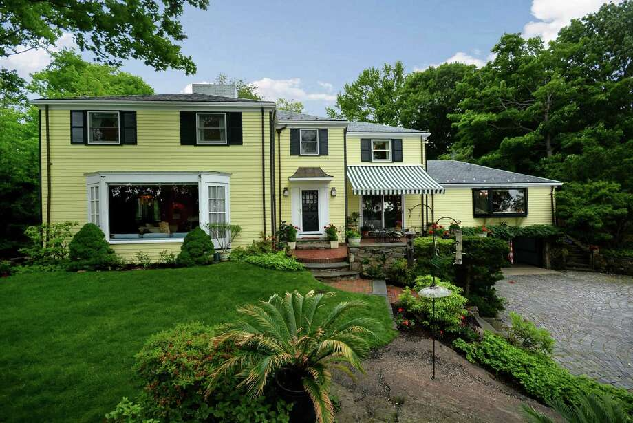 Previously owned by artists, the 1952 Colonial at 67 Salem Straits in Darien has nearly 4,000 square feet of unique  details ó like its custom wallpapered rooms and its random-width peg flooring. It is on the market for $4,195,000. Photo: Contributed Photo, Contributed / Darien News