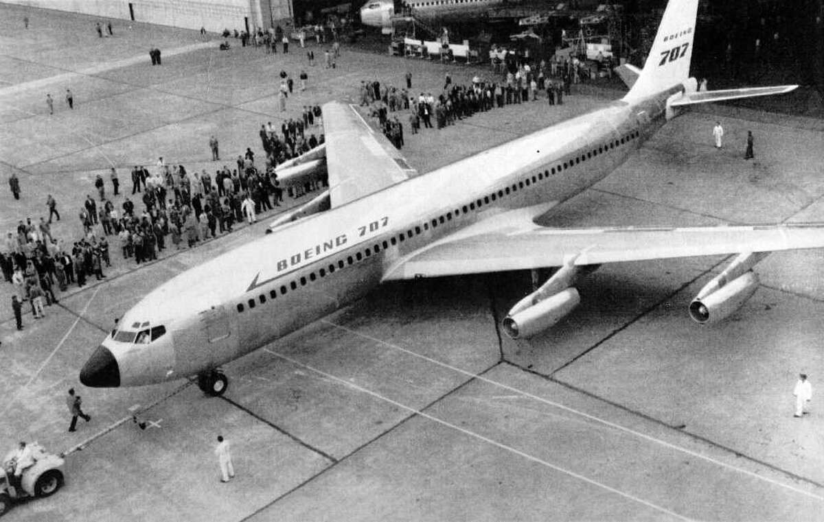 The first Boeing 707 built for commercial service rolls out of its hangar at the Boeing Co. in Seattle on Oct. 28, 1957.