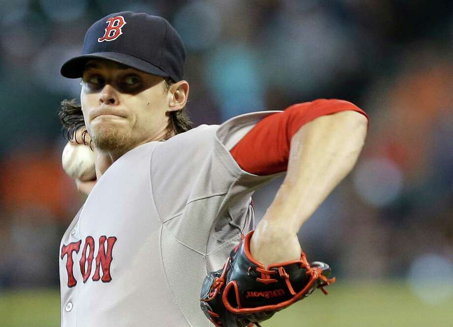 Boston Red Sox's Clay Buchholz delivers a pitch against the Houston Astros in the first inning of a baseball game Sunday, July 13, 2014, in Houston. Buchholz struck out a career-high 12 batters in a win. (AP Photo/Pat Sullivan) Photo: Pat Sullivan, STF / AP