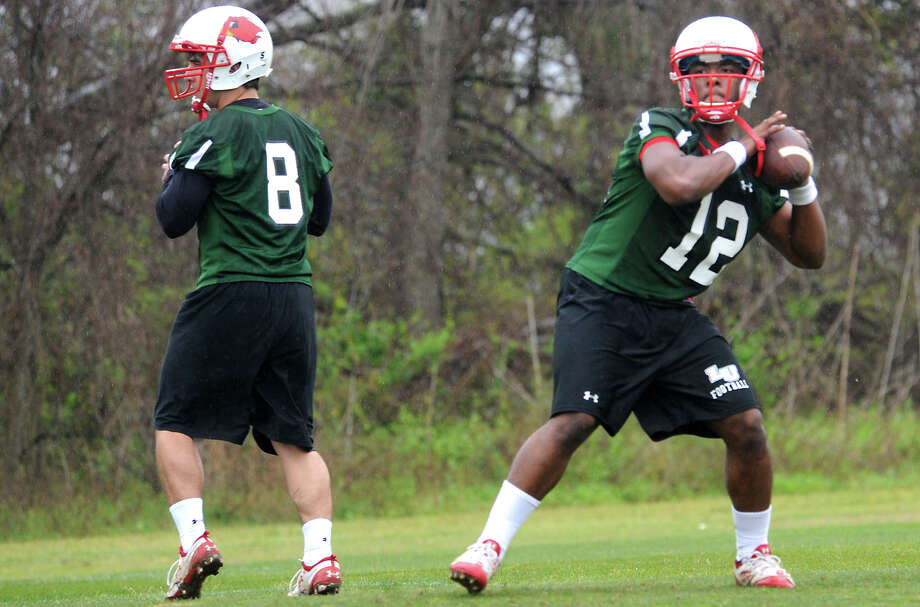 Harison Tatum and Christian Louis throw passes during the first day of spring football practice at Lamar University in Beaumont, Tuesday.  Tammy McKinley/ The Enterprise Photo: TAMMY MCKINLEY / Beaumont