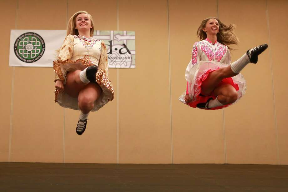 "The jig is up: Jenna Rolf (left) and Gina Goldschmidt of Tir Ruaidh Irish Dance in California dance to ""Reel"" 