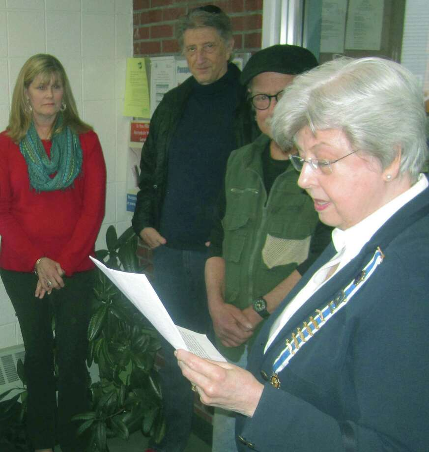 Judy Messer, regent of the Roger Sherman chapter of the Daughters of the American Revolution in New Milford reads the dedication for a Roger Sherman display at the town hall named in his honor. Among those on hand recently for the ceremony were Town Clerk Noreen Prichard, Peter Orenski and local author/historian Michael-John Cavallaro. 2014 Photo: Norm Cummings / The News-Times