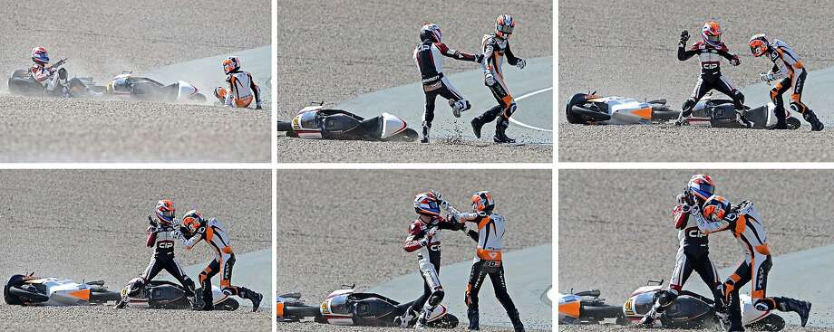 The fighting Dutchmen:After crashing in the Moto3 race of the Grand Prix of Germany at Hohenstein-Ernstthal, Mahindra rider Bryan Schouten of Netherlands (left) and his compatriot, Kalex KTM rider Scott Derouse, apologize to each other and exchange insurance cards try to beat each other senseless. Photo: Robert Michael, AFP/Getty Images