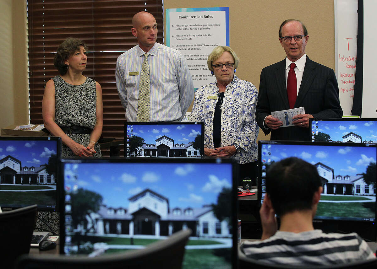 Bexar County Judge Nelson Wolff, right, introduces the latest BiblioTech site to guests at the Warrior and Family Support Center, (WFSC), in Joint Base San Antonio-Fort Sam Houston, Monday, July 14, 2014. The digital library will make available its content to military personnel and families of personnel under going treatment and recovery at Brooke Army Medical Center. Joining Wolff were from left, Bexar County Special Projects Coordinator Laura Cole, WFSC Assistant Director John Wolf and WFSC Director Judith Markelz.