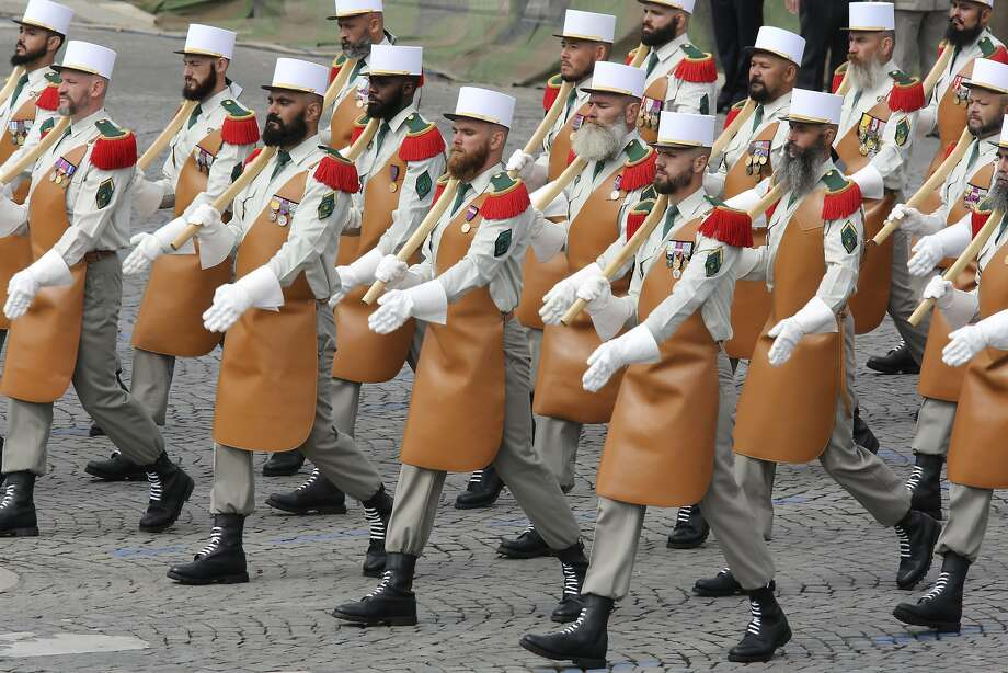 Axes and aprons: Members of the Foreign Legion march in the traditional Bastille Day Parade on the Champs Elysees in Paris. Photo: Remy De La Mauviniere, Associated Press