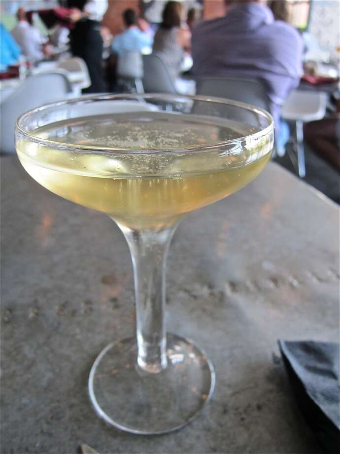 A glass of Cremant de Limoux at L'Olivier, to go with the spicy fried chicken. Photo: Alison Cook
