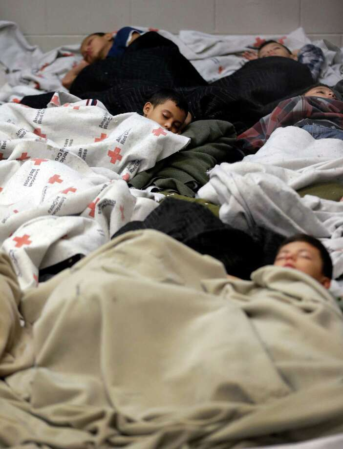 BROWNSVILLE, TX - JUNE 18:  A detainees sleep in a holding cell at a U.S. Customs and Border Protection processing facility, on June 18, 2014, in Brownsville,Texas. Brownsville and Nogales, Ariz. have been central to processing the more than 47,000 unaccompanied children who have entered the country illegally since Oct. 1.  (Photo by Eric Gay-Pool/Getty Images) Photo: Pool / 2014 Getty Images