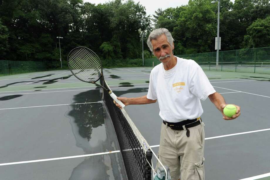 Michael Sette (77) plays tennis in Scalzi Park in Stamford, Conn. on Monday July 14, 2014. Photo: Dru Nadler / Stamford Advocate Freelance