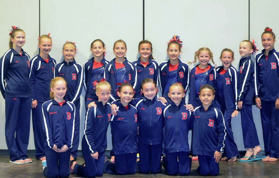 The Darien Level 4 Nationals competitors pose before before the 2014 YMCA Gymnastics National Championship meet in Tampa, Fla. on July 5. Photo: Contributed / Darien News Contributed