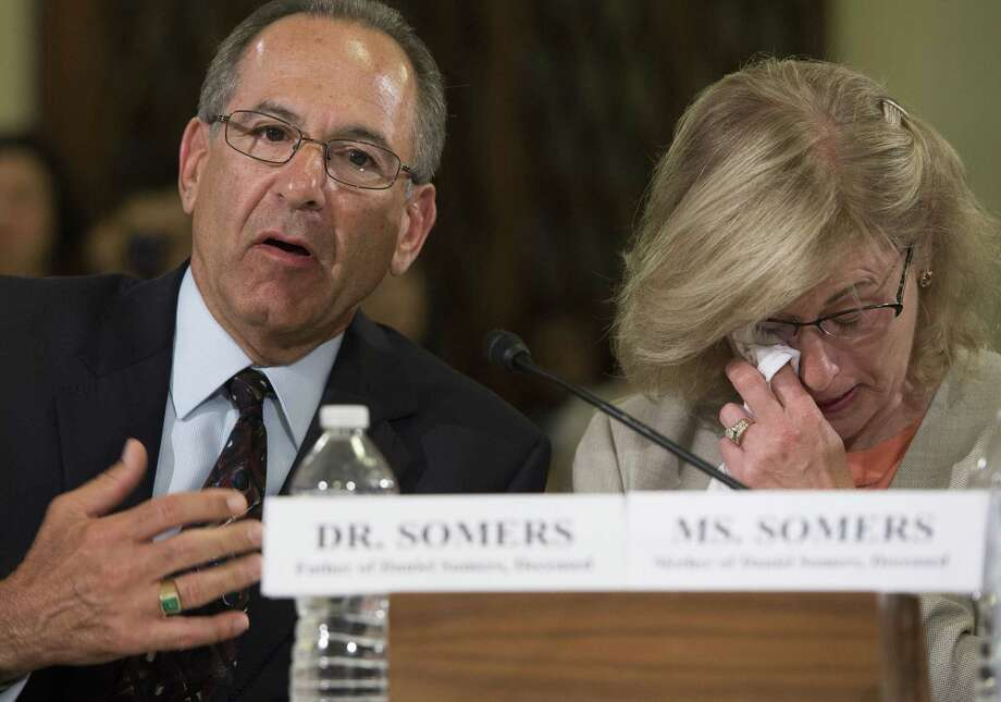 Howard and Jean Somers, parents of Daniel Somers, testify about their son's suicide following tours with the U.S. Army in Iraq, during a House Committee on Veterans Affairs hearing. Photo: Saul Loeb / AFP / Getty Images / AFP