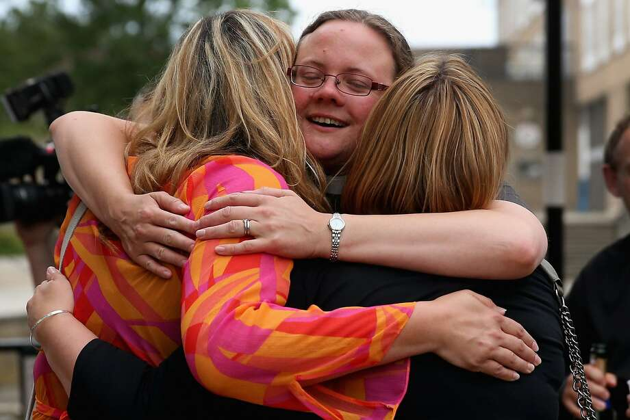 The Rev. Dr. Hannah Cleugh (center) embraces church members at York University in York, England, after the Church of England General Synod voted in favor of ordaining women as bishops. Photo: Christopher Furlong, Getty Images