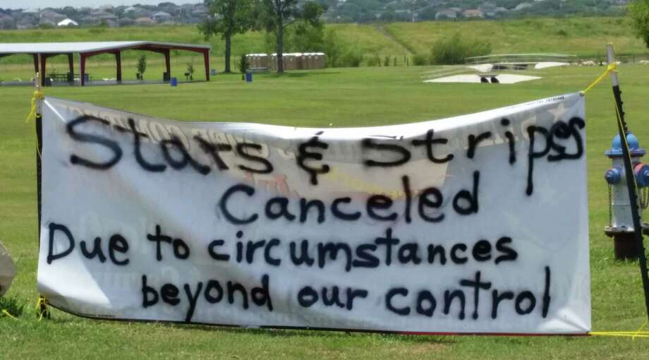 """A makeshift sign posted on July 4 informs the public that the """"Stars and Stripes Over Converse"""" show, slated July 3-6 at Converse North Park, was abruptly canceled on the event's second day. Photo: Courtesy Photo"""