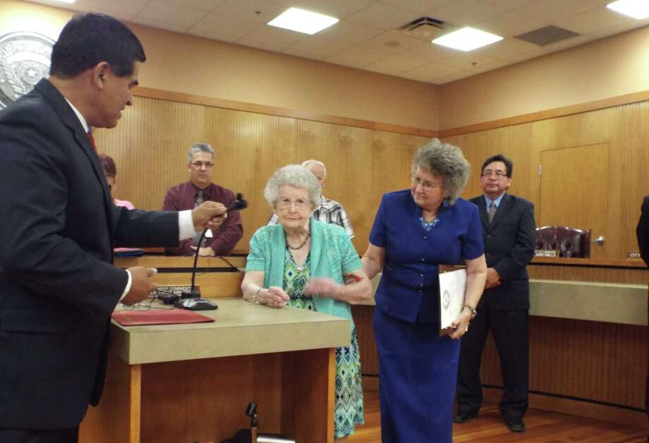 "Converse resident Effie Kern, center, makes her way to the microphone during the July 1 Converse City Council meeting. Kern turned 100 years old July 10 and was the recipient of a special ""Effie Kern Day"" proclamation. At left is Mayor Al Suarez. Kern is aided by her daughter, Dr. Mary Riley. Photo: John Heberling / For The Northeast Herald"