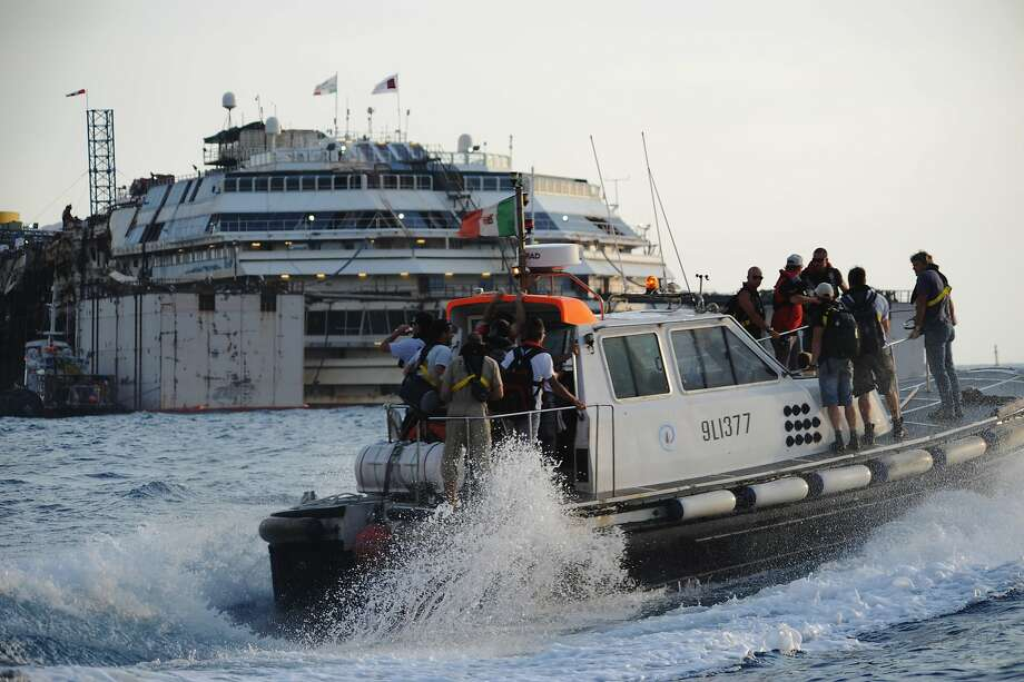 Workers make their way out to the Costa Concordia before the start of the refloating operations. Photo: Laura Lezza, Getty Images