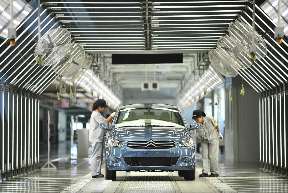 Chinese automobile plants like this one in Wuhan will almost certainly be making more electric vehicles, plug-in hybrids and fuel-cell autos. Photo: Afp, AFP/Getty Images