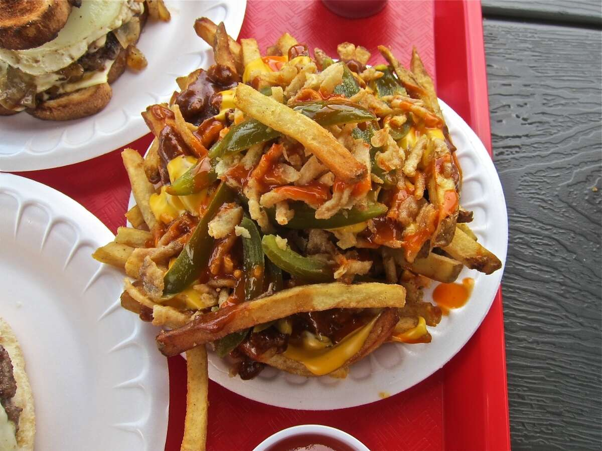 Texas fries with chili, cheese, pickled jalapeños, onions and Krystal hot sauce at Hubcap Grill.