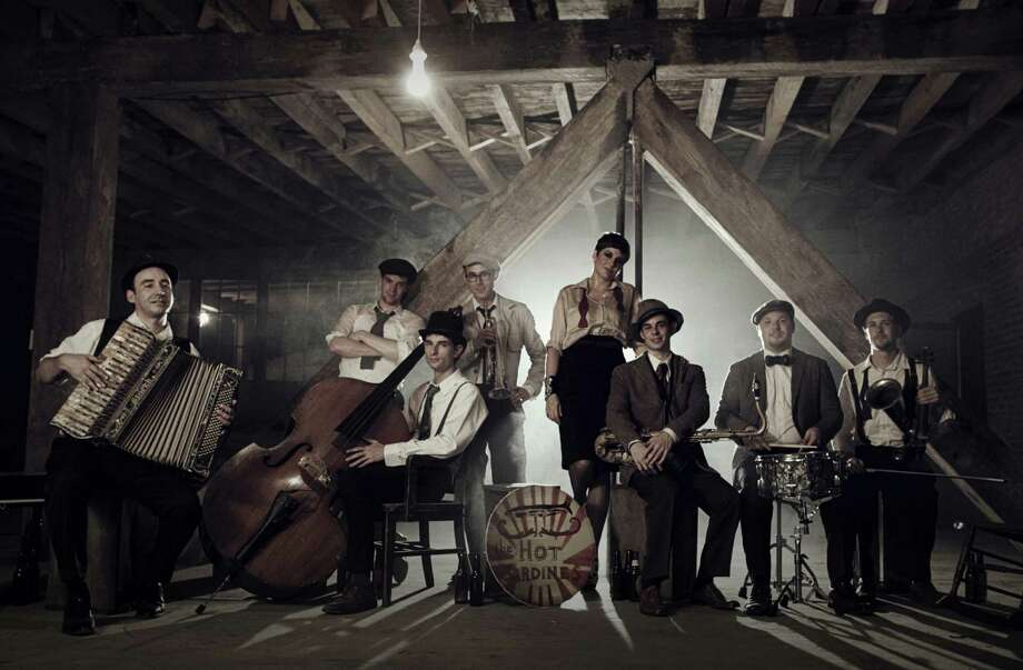 "From left, Evan ""Bibs"" Palazzo, Fast Eddy Francisco, Evan ìSugarî Crane, Jason Prover, Miz Elizabeth, Nick Myers, Alex Raderman and Pete Lanctot are Hot Sardines, a band that will stomp and swing its way to the Levitt Pavilion in Westport, Conn., on Sunday,July 27, 2014, for a free show. Photo: Contributed Photo / Stamford Advocate Contributed photo"