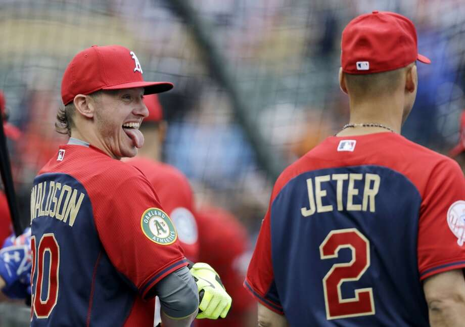 American League third baseman Josh Donaldson, left, jokes with shortstop Derek Jeter during batting practice for the MLB All-Star game. Photo: Jeff Roberson, Associated Press